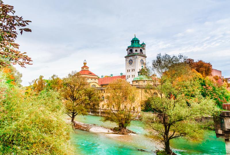 Munich, Germany - autumn view of Isar river with the Muellersches volksbad. Munich, Germany - autumn view of Isar river with the neo-baroque Muellersches stock photos