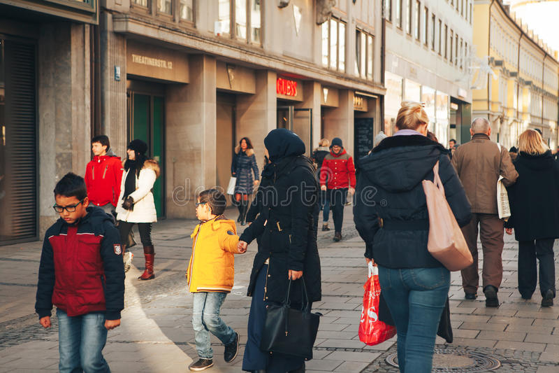 Munich, Germany, December 29, 2016: A friendly family of migrants walks down the street in Munich. Tolerance. Friendliness royalty free stock images