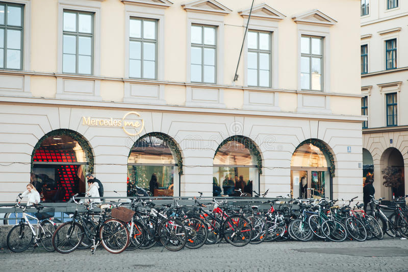 Munich, Germany, December 29, 2016: Many bikes in a row on the street in Munich, Europe. Bicycle parking royalty free stock photography