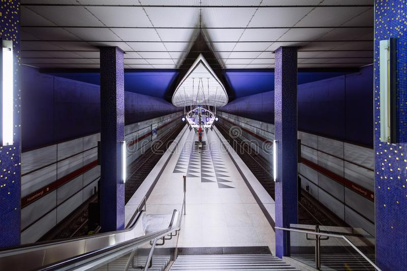 Munich, GERMANY - 18 February: Hasenbergl underground metro station with platform, and curved futuristic design with lights. On a ceiling, situated in Munich royalty free stock image