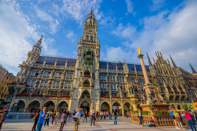 Munich, Germany - July 30, 2015: Stunning image of magnificent city hall building revealing fantastic architectural. Details on a sunny day stock photo