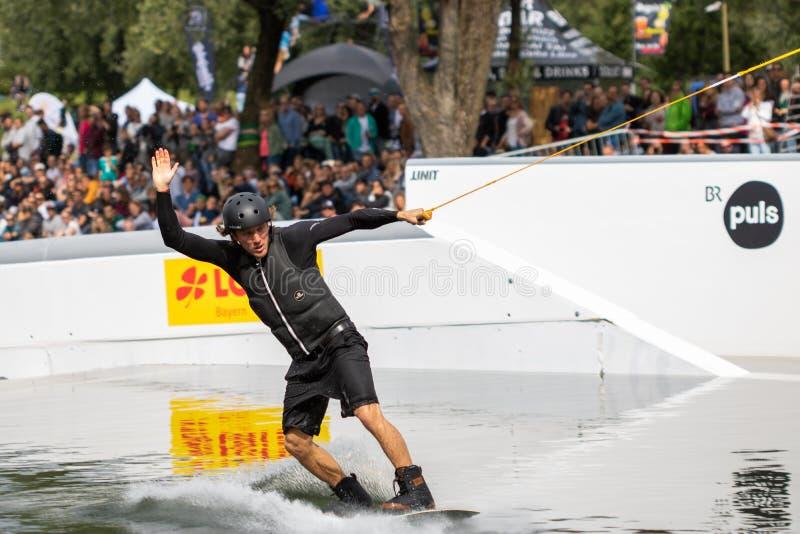 Munich, germany, munich mash - 06 24 2018: wake board rider doing tricks at the munich mash royalty free stock photos