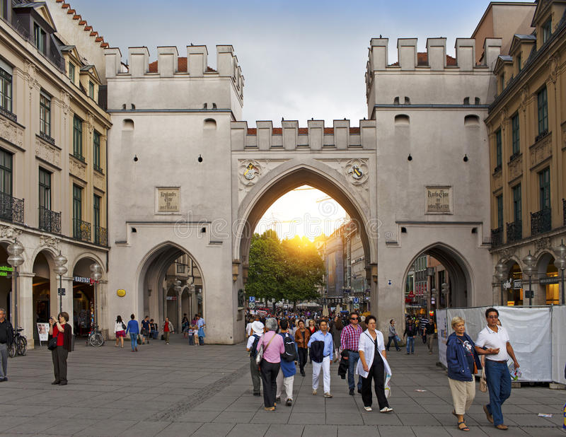 Munich, Germany - May 29, 2012: People walking through the Karlstor gate in Munich, Germany stock photo