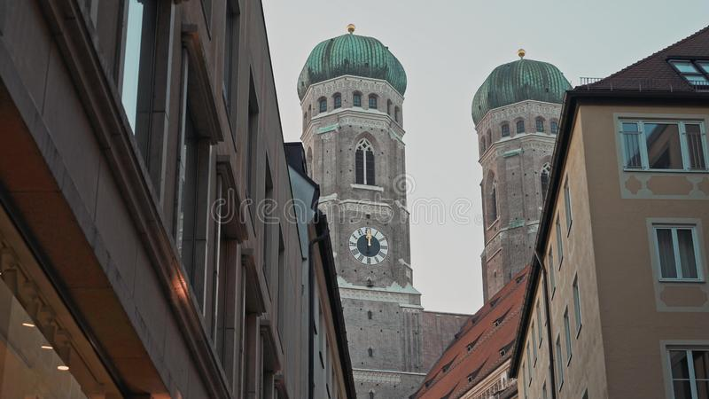 MUNICH, GERMANY - November 28, 2019: Locked down real time medium shot of the domes of the Church of Our Lady royalty free stock photos