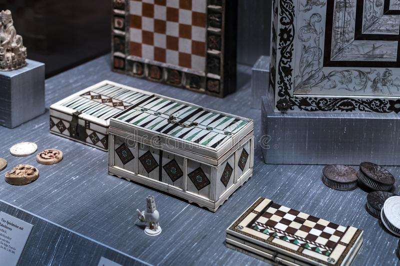 The Represents an exposition of the history of the development of board games chess backgammon poker in the Bavarian National Muse. MUNICH, GERMANY - NOVEMBER 27 royalty free stock photography