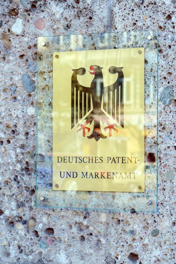 Munich, Germany - October 20, 2017: Wall signboard of the Germa. N patent office with the coat of arms royalty free stock image