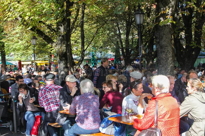 People enjoying drinks and food at Victuals Market in Munich Ger royalty free stock image