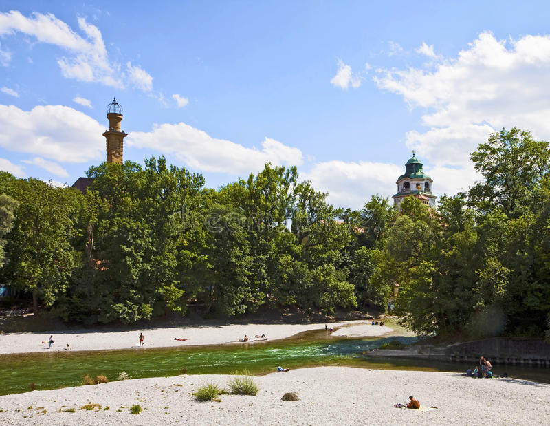 Munich Germany, people relax sun bathing on Isar river banks in royalty free stock photos