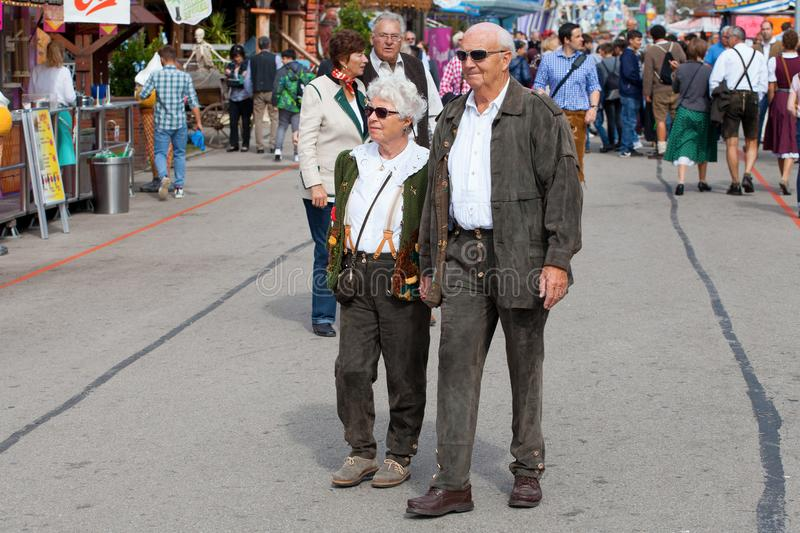 Munich, Germany-September 27,2017: Old couple man and woman in traditional bavarian clothes on the Oktoberfest royalty free stock image