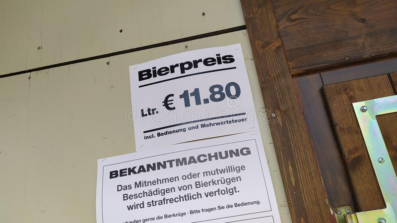 Price of a beer in german language in Oktoberfest 2019 in Theresienwiese area, Munich, Germany. Munich, Germany, september 23, 2019 Price of a beer in german stock images