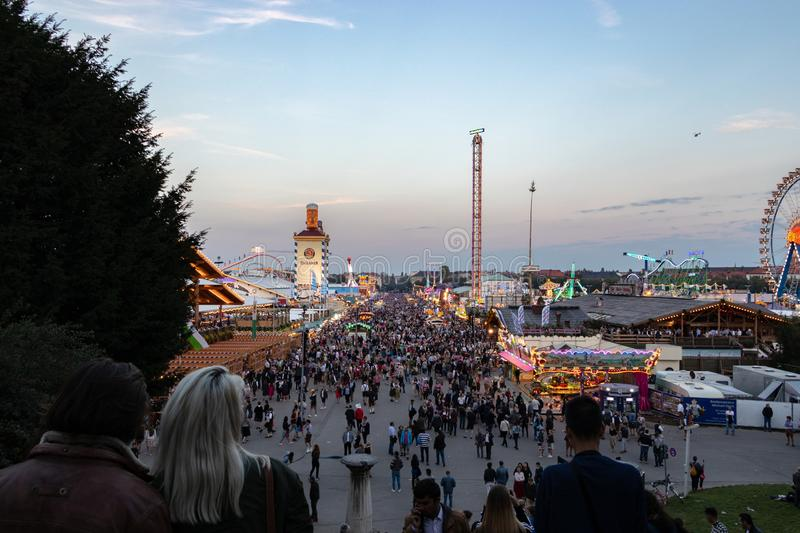 Munich, Germany - September 8: View over the Oktoberfest in Munich. The Oktoberfest is the biggest beer festival of the world. People, bavaria, tradition royalty free stock images