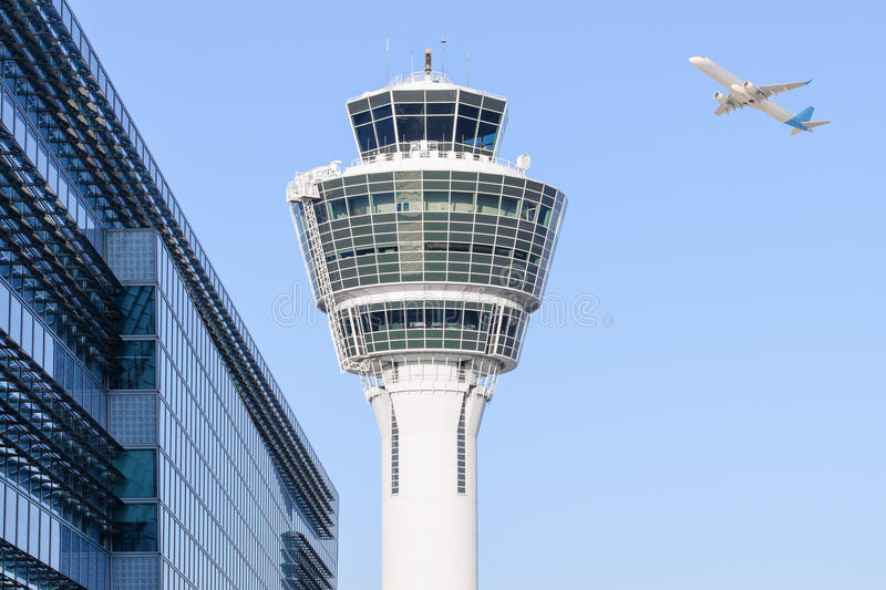Munich international airport control tower and departing taking off. Munich international airport control tower and terminal modern buildings with departing stock images