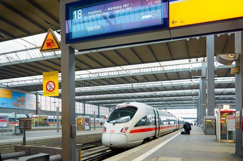 MUNICH, JAN, 12, 2013: Main railway station. ICE electric passenger high speed intercity train ready to run to Berlin. High speed. MUNICH, JAN, 12, 2013: Main stock photo