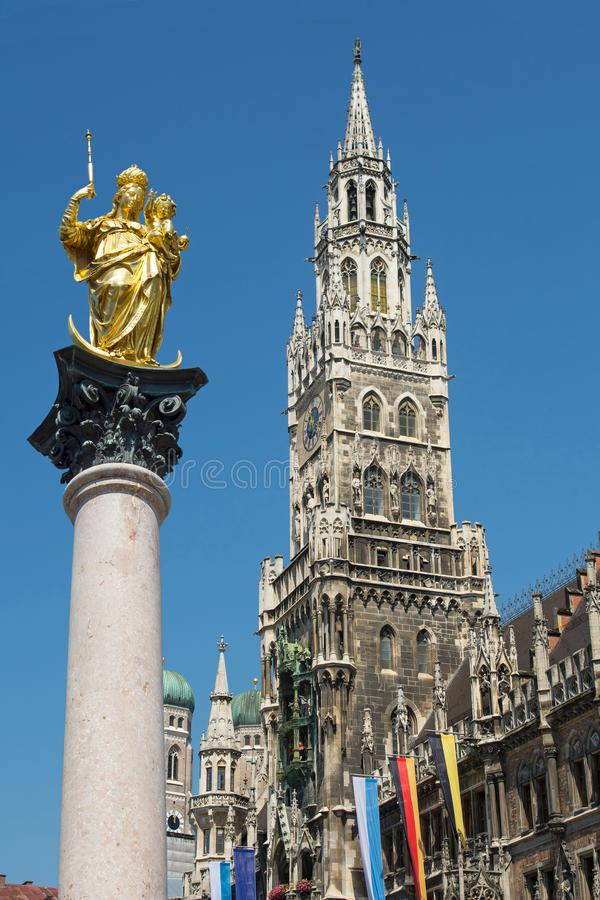 Munich Marienplatz, Germany. The main symbols of Munich, Bavaria, Germany - the golden statue of Saint Mary in Marienplatz, the new town hall Neues Rathaus and