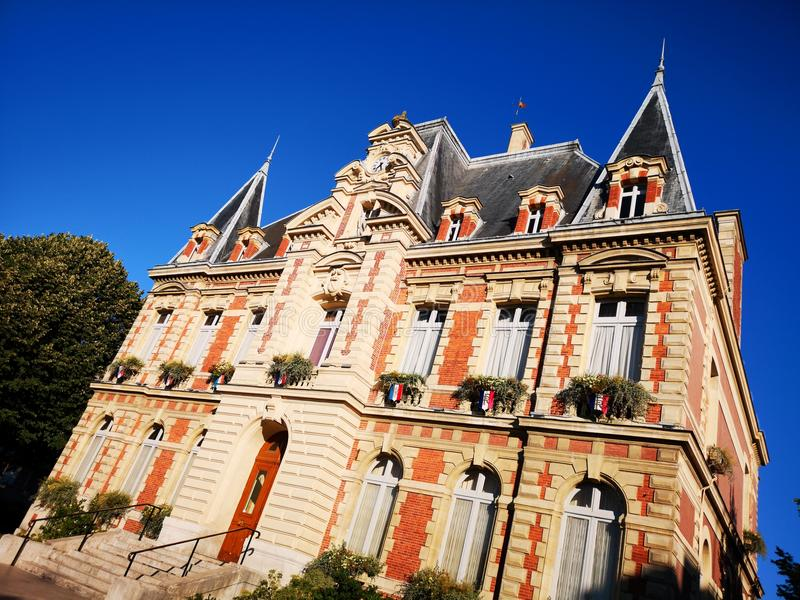 Municipal ancient building in Rueil-Malmaison. In France. Blue sky royalty free stock photography