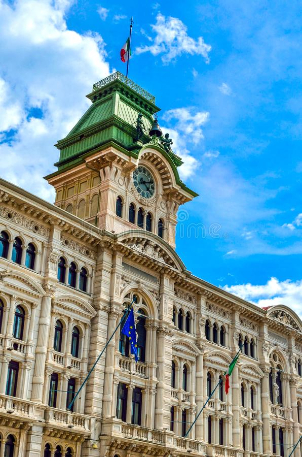 Municipio clock tower building of Trieste in Piazza Unita Italia Italy vertical landmark background stock image