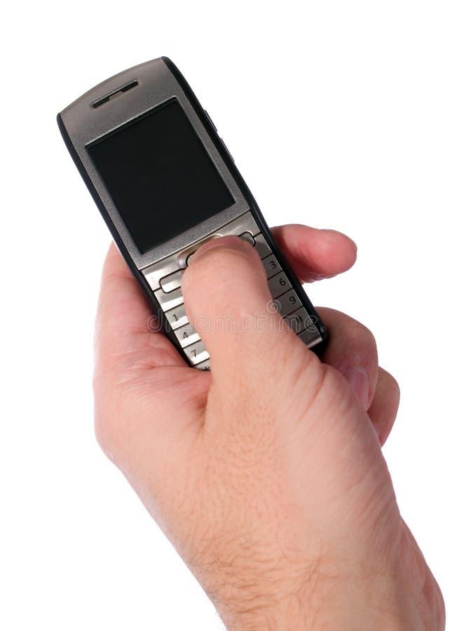 Munisca digitare sullo smartphone isolato su bianco fotografia stock