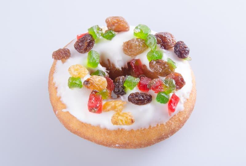 Munk färgrika Donuts på bakgrund arkivfoto