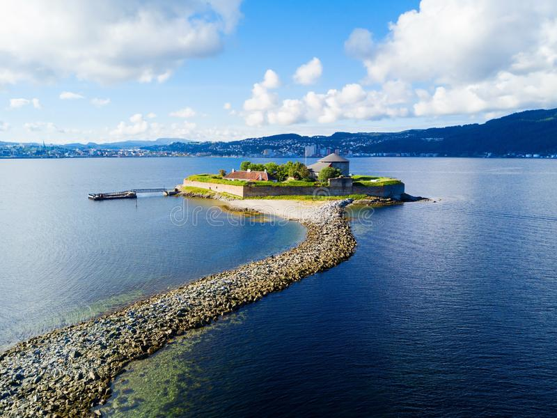 Munkholmen island in Trondheim. Munkholmen is an islet north of Trondheim, Norway. The islet has served as a place of execution, a monastery, a fortress, prison stock images