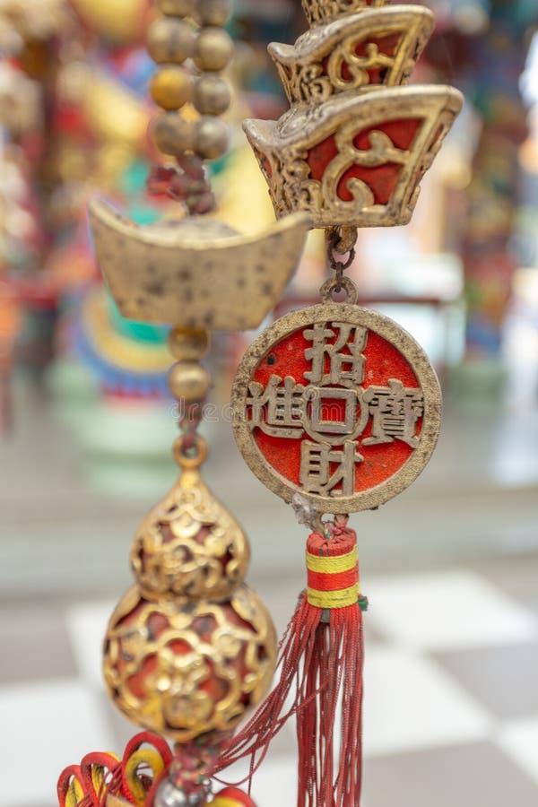 Muntstuk van het hangen van China stock afbeelding