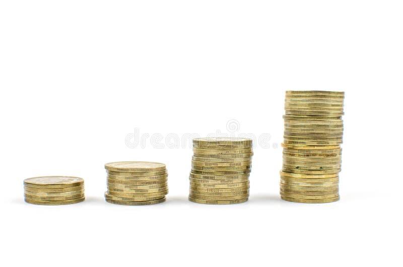 muntstukken op een geïsoleerde achtergrond Besparingsgeld, die voor de totstandbrenging van een droom accumuleren royalty-vrije stock foto's