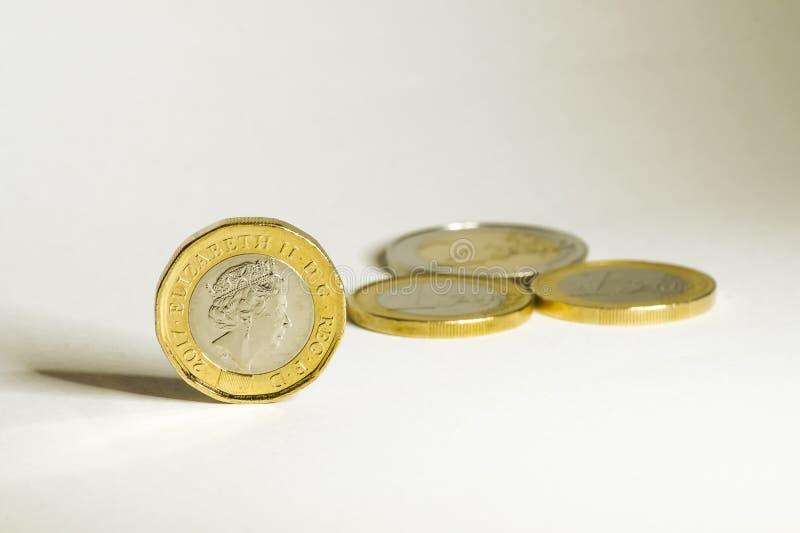 Muntstukken van euro en pond before and after brexit stock fotografie