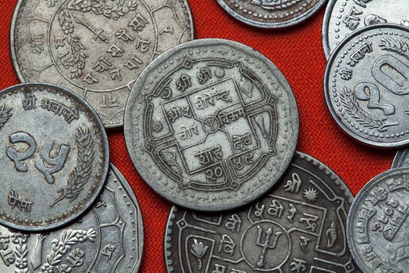 Muntstukken van Nepal stock afbeelding