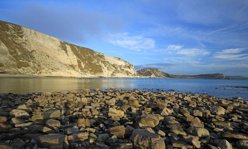 Download Mupe Bay Dorset stock photo. Image of sunset, clouds - 22867712