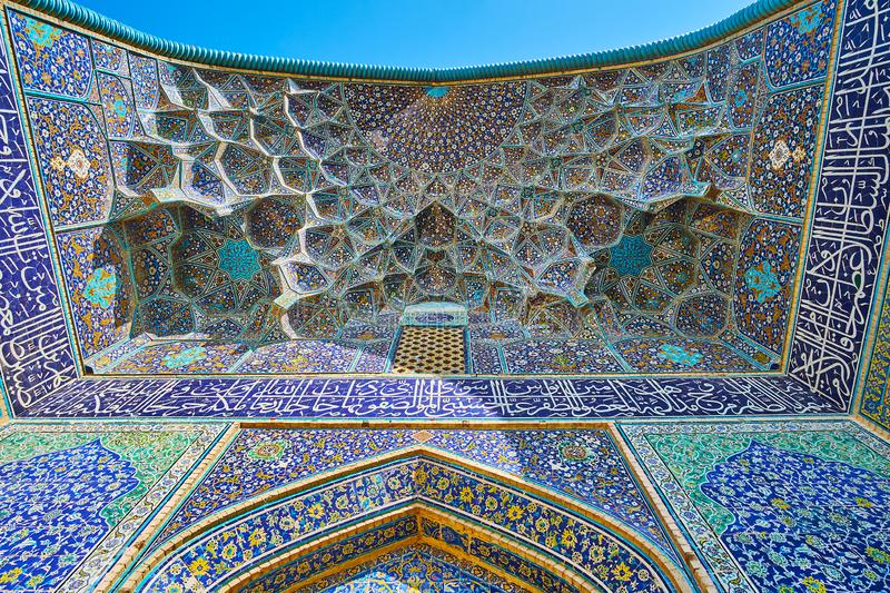 Details of portal of Sheikh Lotfollah Mosque, Isfahan, Iran. The muqarnas arch of the medieval portal of Sheikh Lotfollah Mosque, famous for its stunning tiling royalty free stock photography