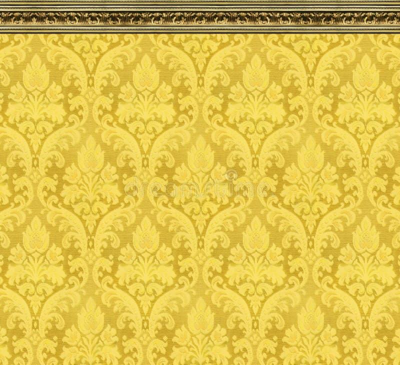 Mur élégant de papier peint jaune de damassé avec le bâti fleuri image stock