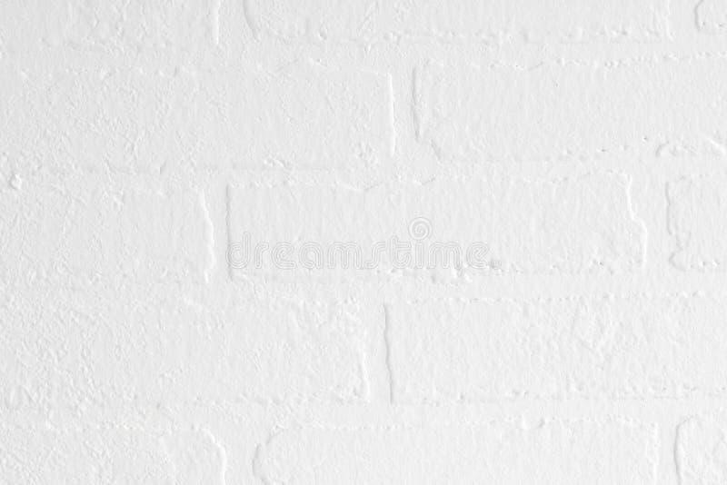 Mur blanc avec le modèle de brique comme fond images stock
