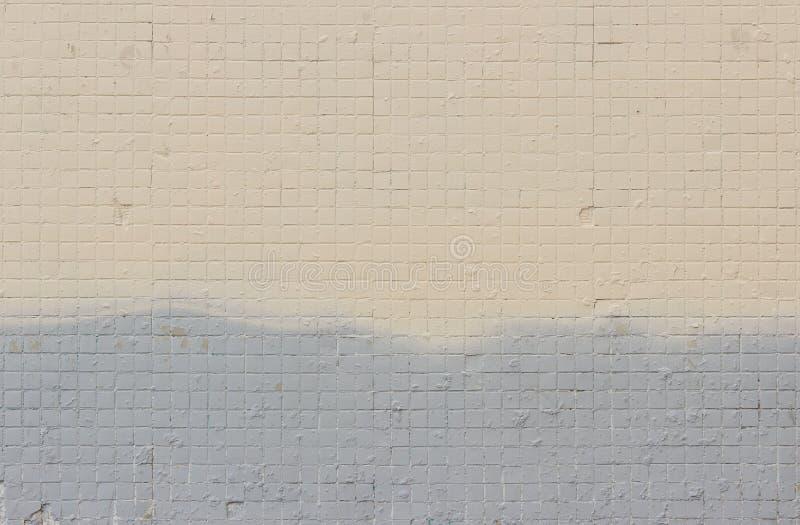 Mur Couvert De Tuiles Peintes Sur La Peinture Beige Et