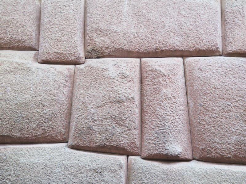 Mur d'Inca fait de pierres volcaniques naturelles Cusco Pérou photo libre de droits