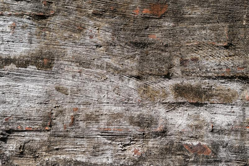 Mur de briques avec le ciment mince photo stock
