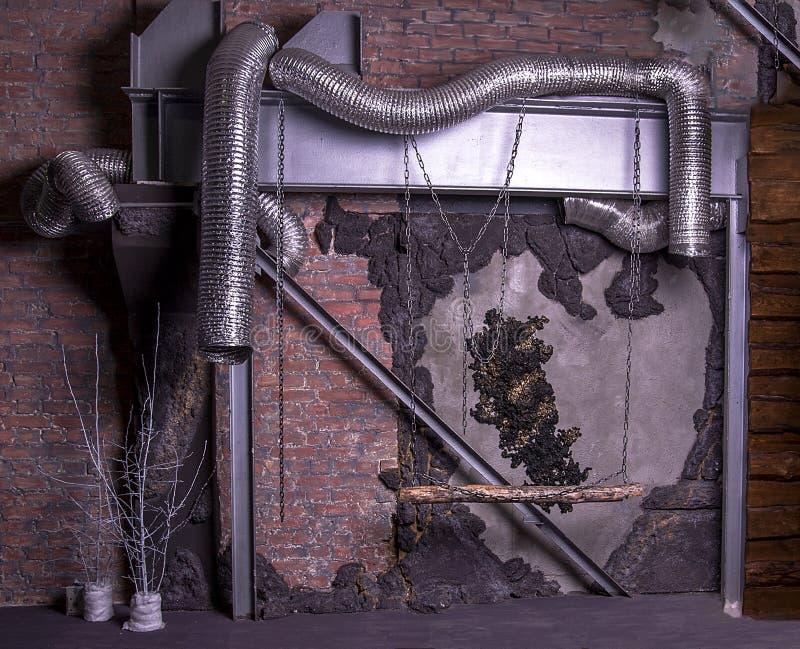 Mur de briques de rouge de tuyau en métal photos libres de droits