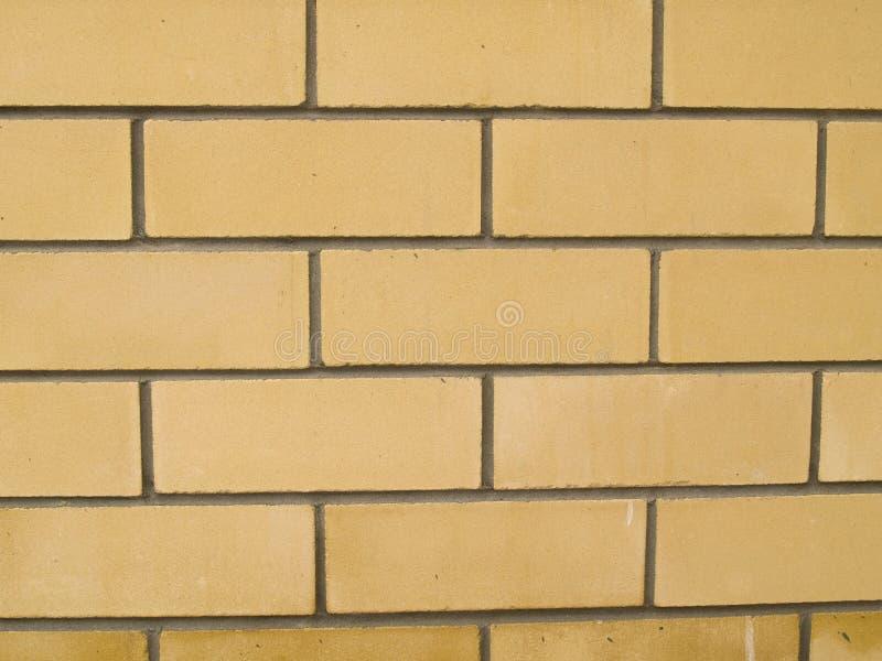 Mur de briques de Yelow image stock