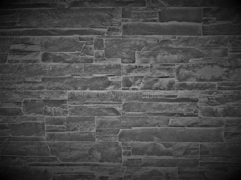 Mur de mur de briques en pierre ou noir décoratif naturel image stock