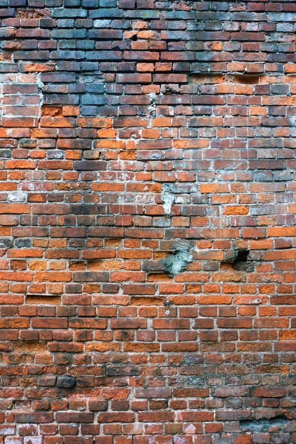 Mur de briques endommagé photos stock