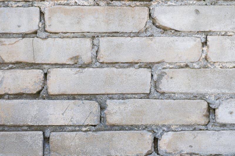 Mur de briques gris pour le papier peint photo stock Mur de brique gris