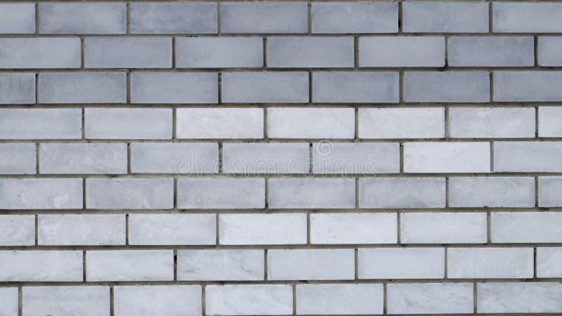 Mur de briques gris urbain images stock