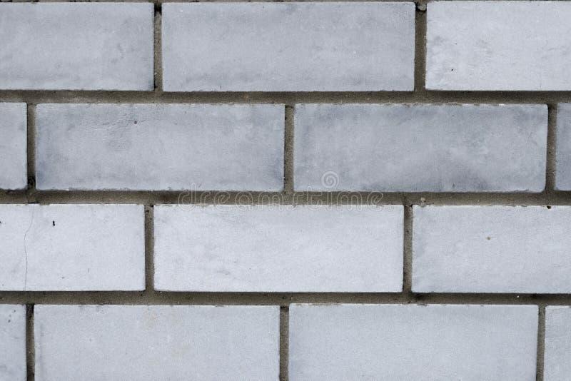 Mur de briques gris urbain photos stock