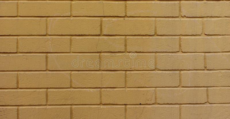 Mur de briques jaune photo stock