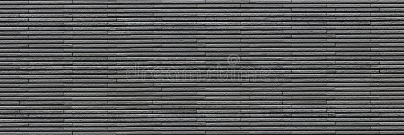 mur de briques moderne gris-foncé horizontal pour le modèle et le fond image libre de droits