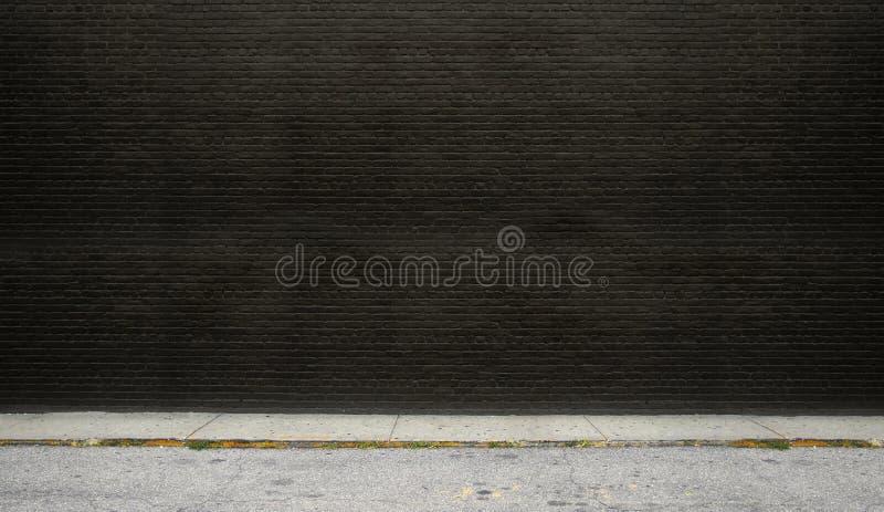 Mur de briques noir sur la rue image libre de droits