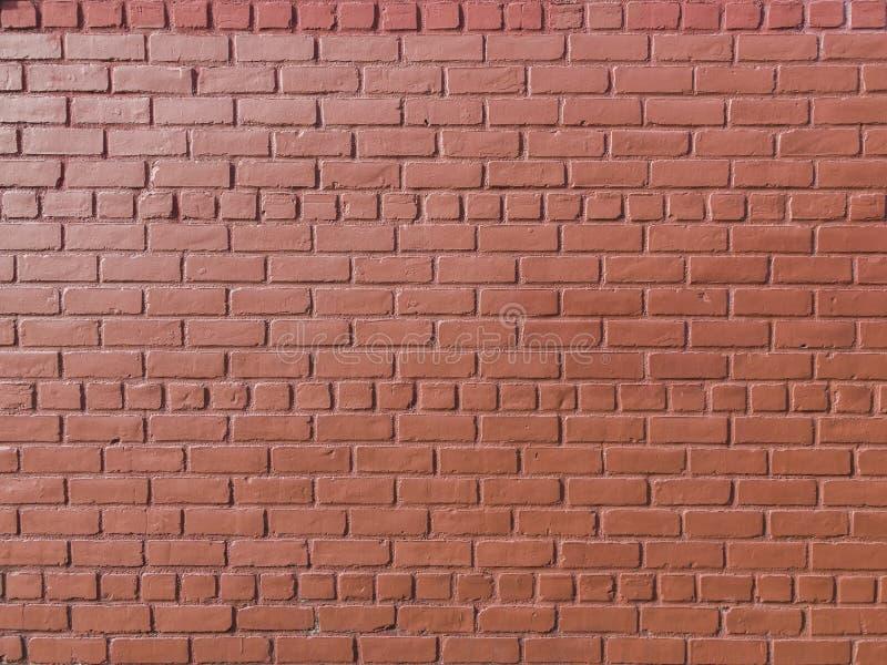 Mur de briques peint rouge image stock