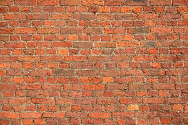 Mur de briques de rouge de vintage photos stock