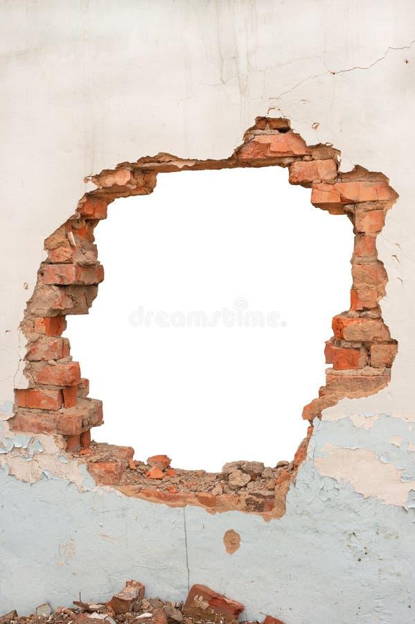 Mur de briques de trou photo stock