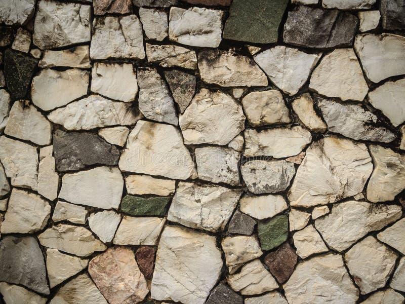 Mur de pavé rond de nature de vintage dans le patt désorganisé de disposition photo libre de droits