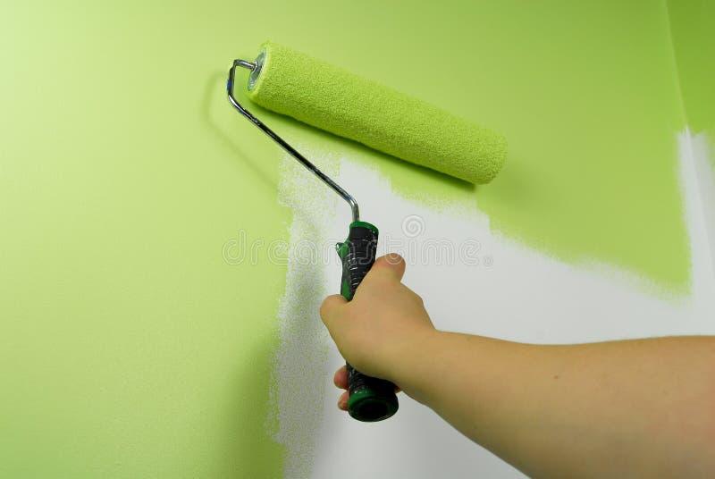 Mur de peinture de main en vert photographie stock