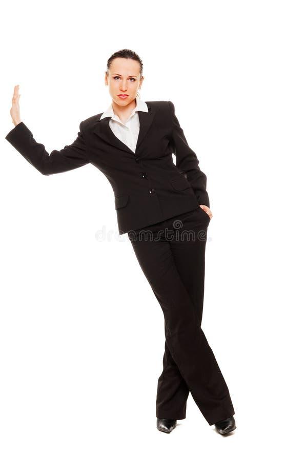 mur de penchement de femme d'affaires image stock